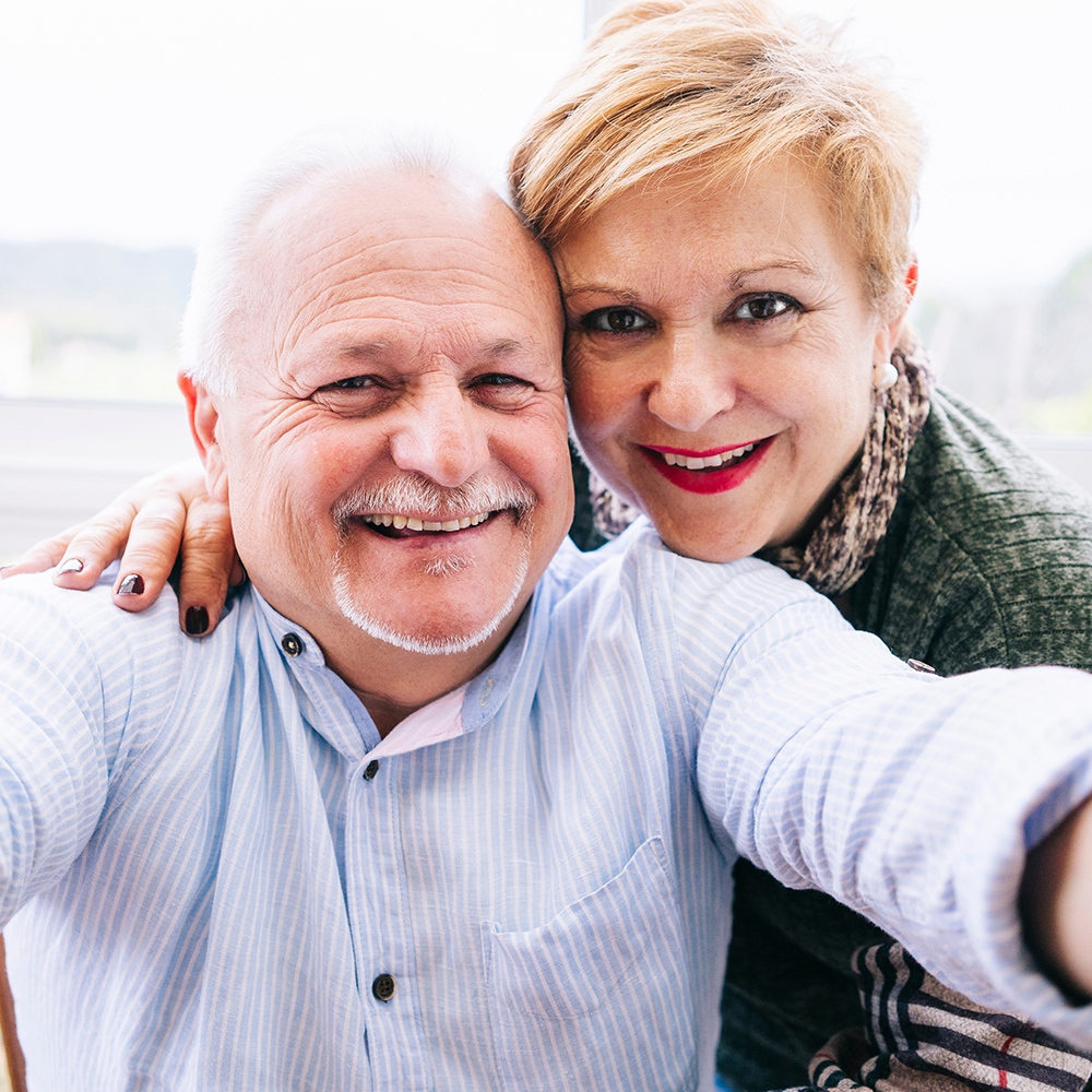 couple happy about their life insurance policy